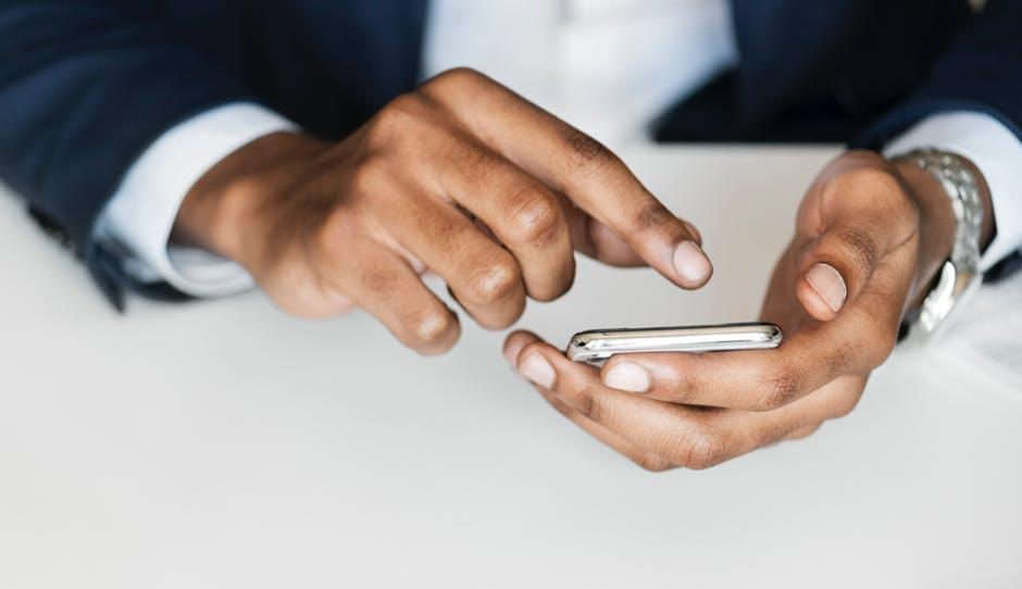 Описание: Man in Black Suit Holding Smartphone